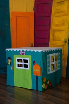 Card Table Playhouse - if I made one, I don't think it would be as elaborate as this one, but I love the idea.  Great birthday present.