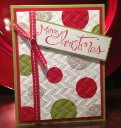 handmade Christmas card ... red, white, green & silver... variety of circles glued on white and then embossed with chevron embossing folder .. like the look ... Stampin' Up!
