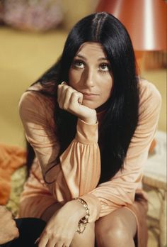 Cher Dark, waist-length hair, parted down the middle. That was Cher's claim to beauty fame (we guess her acting and singing factored in there as well.) The '60s star still makes headlines today and has managed to keep her iconic mane pretty much status quo, minus the odd cut, wacky experimentation and curly adventure here and there. In Cher's case, simple translates to memorable.