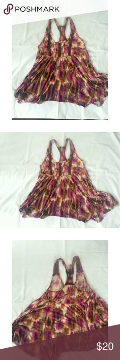 Free People flowy racerback top. Super cute Free People flowing racerback tank top..in shades of brown, plum, and orange. Excellent used condition. Free People Tops Tank Tops