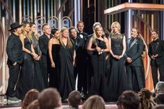 Actors in Big Little Lies on stage at the Golden Globes 2018 after their win for Limited TV series...Robert Pattinson is in the corner of the pic (he & Emma Watson presented the award moments earlier.)