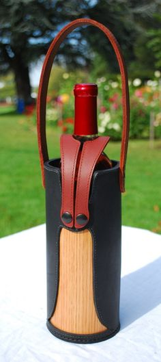 Single wine bottle tote in black and red leather with oak veneer. Etsy sale item.
