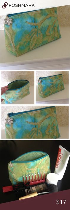 """Handmade cosmetic bag  So cute and a great gift!  Fabric zippered cosmetic bag that is fully lined and completely machine washable!  Lots of room for lots of stuff!  Metal zipper pull included but you might want to remove it before washing.  Measures 9""""x4"""" wide and 5"""" tall.  Handmade by me.  I have been sewing and crafting for 45 years and try to put a little charm and professionalism in everything I make.  More styles to come!  Accessories"""