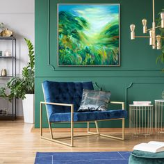 Farrow and Ball green paint on the panelled walls accentuates this stunning interior design. The crushed blue velvet armchair is a thoughtful touch living room. The large square abstract statement piece painting and gold brass light fittings are perfect. The indoor plants make it fresh and clean.  #goldlamp #goldlightfitting #bluerug #paneling #abstract #landscape #statement piece #living room #art #british artist #greenery #brushstrokes #bold #colours #britishlandscape Velvet Armchair, Teal And Gold, Gold Wood, Blue Rooms, Room Art, Light Fittings, Blue Velvet, Abstract Landscape, Patio Ideas