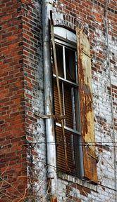 Idea: Framed brick photos to recreate exposed brick wall, black frames