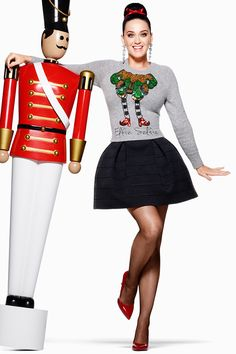 Follow Katy Perry's inspirational lead and add a twist to your seasonal look by pairing a sophisticated skirt with a humorous holiday jumper. #HappyandMerry