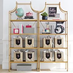 """Maison Bookcase, 33.25""""w x 16""""d x 77.5""""h, crafted of iron and sheet metal, hand finished in antique gold, $599"""