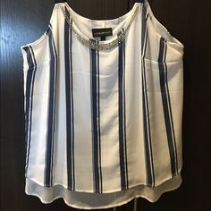 LOWERED! Lane Bryant dressy blue& white tank NWOT Lane Bryant dressy blue & white tank/blouse top with adjustable straps in back. No low ballers. All reasonable offers considered. I also offer bundle discounts. Thank you for stopping by and Happy Poshing! Lane Bryant Tops Tank Tops