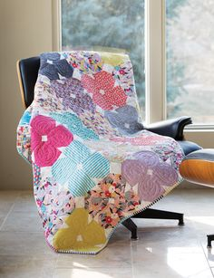 Making this quilt is super simple (and accurate) when you use Deb Tucker's new Corner PopTM tool. Learn how to make Pretty Posies with our free video tutorial.