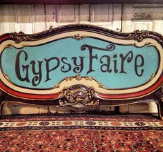 GypsyFaire painted sign repurposed from a footboard