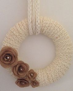 This is a handmade and one of the kind Christmas wreath. It was made with great attention to details and the burlap flowers give it an elegant