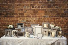 Collect photos from friends and family from their wedding day. Frames can be borrowed or purchased from thrift stores!