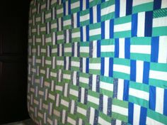 Basket weave pattern quilt in gradient blues and greens