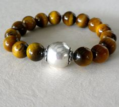 Gold and Brown Smooth Round Tiger Eye Stones and by BijouxJewellry, $46.00