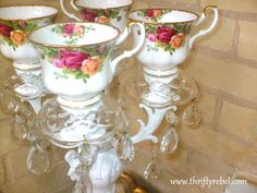 Give a vintage gold table top candle holder a makeover and repurpose it as a teacup candelabra