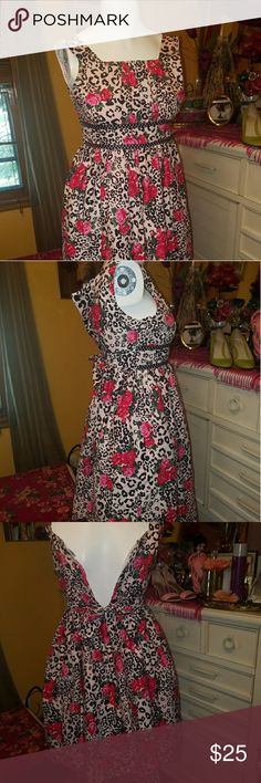 Roses Cheetah Print Dress Lovely, unique, one of a kind, now your daughter can also be stylin' with you. So adorable. This dress says it's a size 12 but I think it fits a 10 year old best. Has black thin ribbon with white dots. Just such a creative floral dress. Everything you love in one place, roses, ribbon, and animal print in one place! One of a kind. Mannequin is a woman's size but you get the picture!⚘鹿 Sweet Heart Rose Dresses