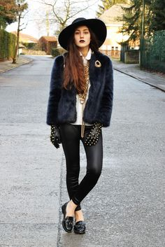 20 Ways to Wear Colorful Fur - wide brimmed hat worn with a navy blue fur coat, layered jewelry + second-skin leather leggings, chic loafers and studded black gloves