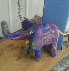my multi coloured elephant which is needle felted