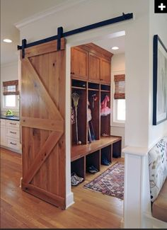 "DIY Barn Door Track Tutorail Good idea, and stylish for a rustic home too! ""mudroom – love the barn style door so you can close it off if you need to but leave it open most the time without some door in the way!"" @ DIY Home Design Barn Door Track, Diy Barn Door, Diy Door, Barn Door In House, Poll Barn House, Wood Barn Door, Style At Home, Eclectic Kitchen, Design Case"