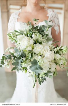 White and green bridal bouquet with roses | Flowers by Alsmeer Flowers | Photograph by Nadine Aucamp |