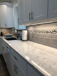 "Quartz counters in LG Viatera using Minute color are enhanced by the look of the grey subway tile and a ""bubbles"" accent strip. Kitchen Room Design, Kitchen Wall Tiles, Kitchen Cabinets In Bathroom, Modern Kitchen Design, Interior Design Kitchen, New Kitchen, Kitchen Decor, Kitchen Backsplash, Cuisines Design"