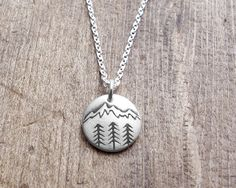 A tiny mountain necklace! You can see a larger version of this and my other mountain themed designs here: