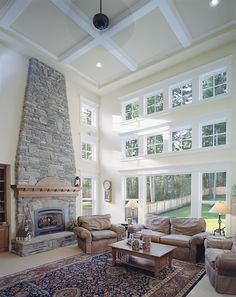 Windows and two story space make this living room a delight!  Craftsman House Plan # 551195.