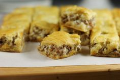 3-Ingredient Crescent Sausage Bites /  ~~~Fry up some sausage, mix it with cream cheese, and sandwich it between two layers of crescent roll dough.  Bake it and cut it into small squares.  Done!    1 lb. hot sausage (pork or turkey)   1 (8 oz.) package cream cheese   2 packages crescent rolls