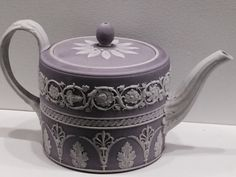 Wedgwood teapot. Around 1790. Jasper, solid white ground with lilac wash and white relief. located at the Birmingham Museum of Art.