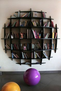 interior design home decor furniture shelves shelving bookshelves--could paint to look like a sports ball. Creative Bookshelves, Bookshelf Design, Round Bookshelf, Book Shelves, Vintage Bookshelf, Modern Bookshelf, Bookshelf Plans, Bookshelf Ideas, Simple Bookshelf