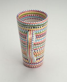 Adorable tall mug...love this hand painted mug, great colors and it holds enough coffee for my rabid addiction!
