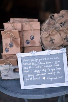 Wedding favor pralines and dog cookies.... (wish I would've wrapped the dog cookies to prevent the oil stains on the dog bags-oops!)