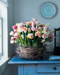Birch-Wrapped Basket with Tulips and Daffodils | Martha Stewart Living - This oversize nest cradles an exuberant mix of blooms from spring-flowering bulbs -- the botanical counterpart to newly hatched birds.