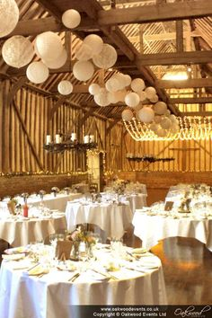 The barn, with white and white lace paper lanterns and fairy lights White Paper Lanterns, Hanging Lanterns, Spring Wedding, Dream Wedding, Event Lighting, Wedding Lighting, Barn Parties, Ceiling Decor, Wedding Styles