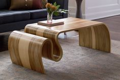 Crazy Carpet Table by Kino Guerin. With a sculptural form rippling like fabric, this extraordinary wood table possesses a modern aesthetic and a sense of movement. Using vacuum press lamination, the artist coaxes flat plywood sheets into dramatic curves finished with wood veneer.