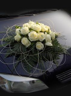 Roses bunch with leaves on motorhood of getaway ca. Roses bunch with leaves on motorhood of getaway car - Flower Arrangement Designs, Church Flower Arrangements, Floral Arrangements, Funeral Flowers, Wedding Flowers, Wedding Car Decorations, Wedding Cars, Hotel Flowers, Bridal Car