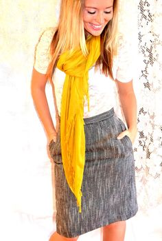 Scarves always add a nice touch to an outfit, try a colorful scarf for a pop of brightness