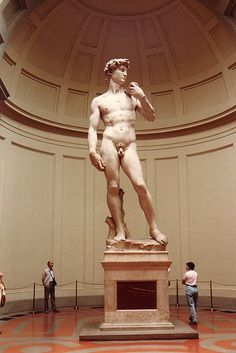Michelangelo Statue of David Florence Italy. This picture gives the viewer some idea of the scale of this marble statue.