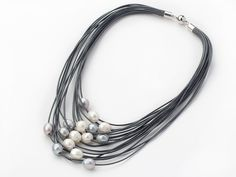 Multi Strands 11-12mm Natural White and Gray Freshwater Pearl Gray Leather Necklace: http://www.aypearl.com/wholesale-pearl-jewelry/wholesale-jewellery-X3043.html