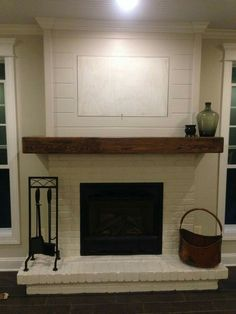 Living Room Fireplace: Painted brick, wood mantel and shiplap. Fireplace Redo, Shiplap Fireplace, Fireplace Remodel, Fireplace Design, Fireplace Ideas, Painted Fireplaces, Fireplace Candles, Country Fireplace, Fireplace Pictures