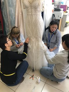 Our creative director (Pictured on the phone) with our Seamstresses R, Jan  Sunn (L to R) with some last minute touches on a wedding gown. #weddingdress #dress #fashion #craftsmanship