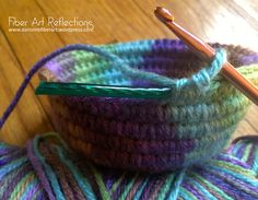 Fiber Art Reflections: Small Crochet Coiled Basket Tutorial - crocheting over clothesline for a sturdy basket
