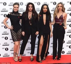 Gothic glam: Little Mix were looking their best at the awards in their sombre and sexy ens...