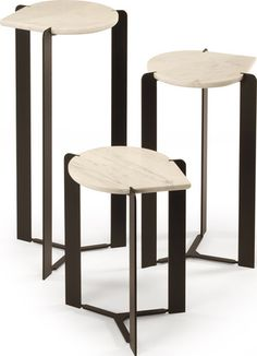 A drop of industrial elegance for modern interiors. The Skram Furniture Drop Side Table pairs a blackened steel base with a unique teardrop-shaped slab of Carre
