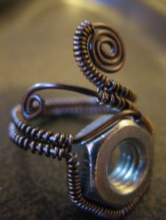 Steampunk Industrial bolt wire wrapped ring, Gunmetal wire  , via Etsy.