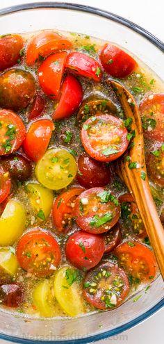 Marinated cherry tomatoes are a colorful, juicy and tasty side dish that is perfect for summer parties, buffets and large gatherings because it can be made hours in advance. This is one of our favorite cherry tomato recipes! Italian marinated tomatoes with just 4 ingredients!   natashaskitchen.com #marinatedtomatoes #cherrytomatoes #italiantomatoes #marinatedcherrytomatoes #cherrytomatorecipes #tomatoes #tomatorecipes #saladrecipes #salad #sidedish #easyrecipes #allrecipes #natashaskitchen