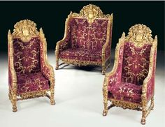 A Continental Baroque style giltwood three-piece salon suite