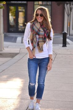 Cute fall look: long sleeve white tee, plaid scarf, jeans, sneakers.