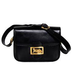 CELINE Vintage Horse Carriage Buckle Black Box Leather Shoulder Bag | From a collection of rare vintage shoulder bags at https://www.1stdibs.com/fashion/handbags-purses-bags/shoulder-bags/