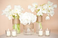 different flowers, wrapped mason jars, filled with lemon slices or wedges